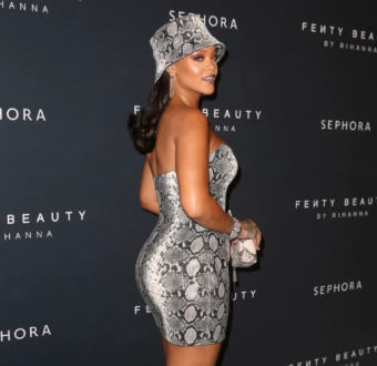Rihanna stuns in head to toe python print as she shows off her fuller curves